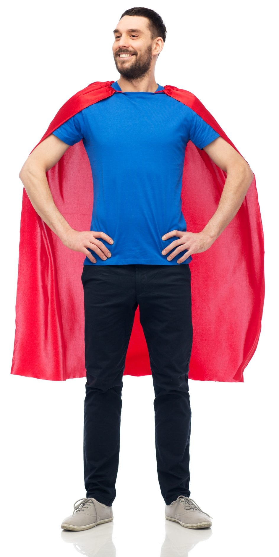 power and people concept - happy man in red superhero cape over white